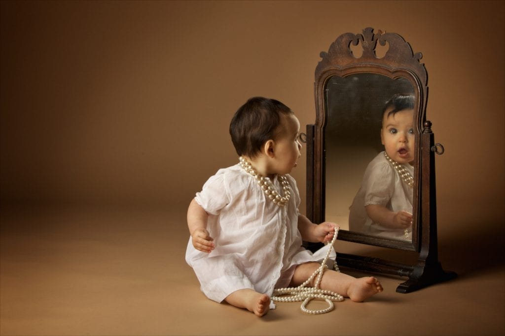 baby looking in mirror