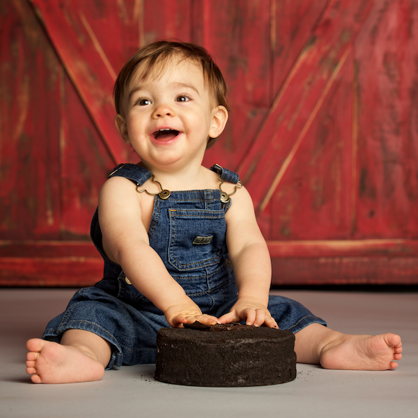 photo of baby smashing cake